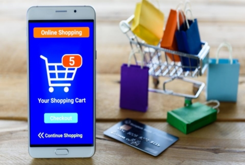 Smart phone showing online shopping cart.