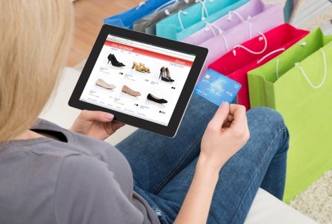 Shopping for footwear on ecommerce website.