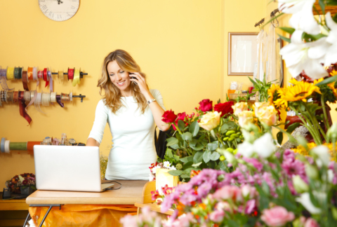 Florist taking an order on her ecommerce website.