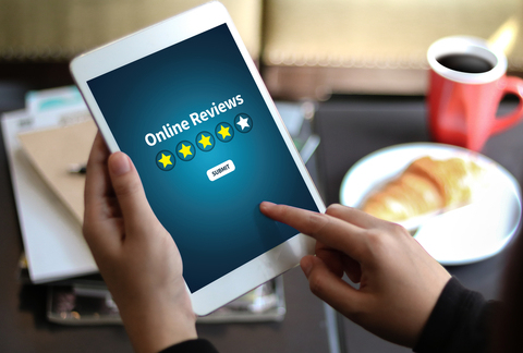 Tablet device showing SEO star ratings for local businesses.