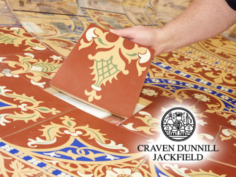 Close up of ceramic tiles and logo on website home page.