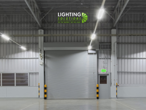 Lighting solutions logo against shutter doors