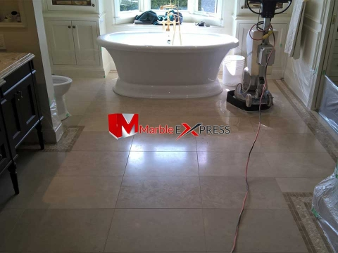 Highly polished granite bathroom floor