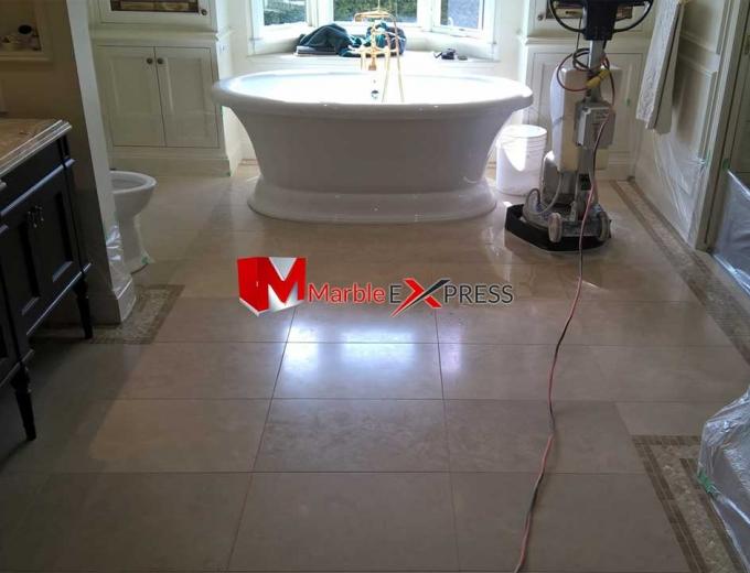Highly polished granite bathroom floor