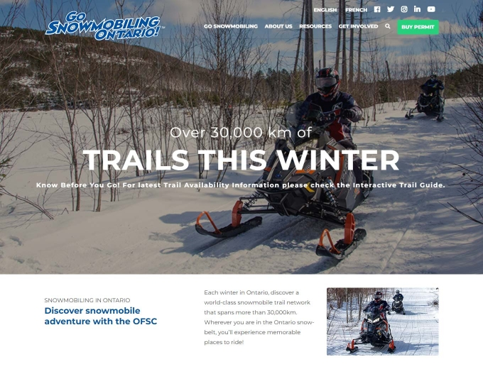 Snowmobile in action on the OFSC website design