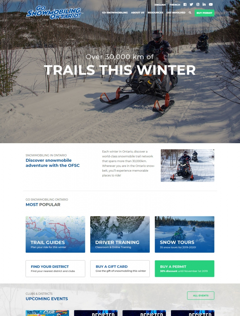Snowmobilers having fun on a groomed trail