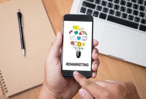 Remarketing icon on cell phone screen