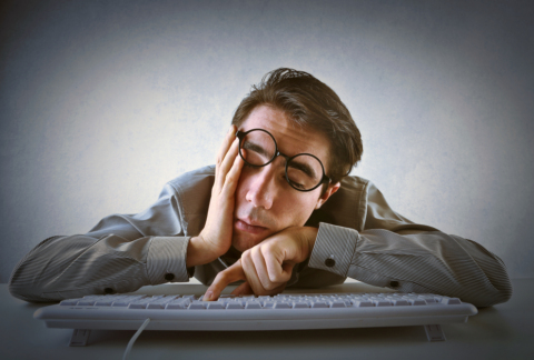 Man working from home dozing off at desk